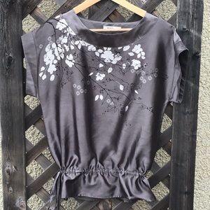Ricki's shiny top w/ flower print & tie at waist